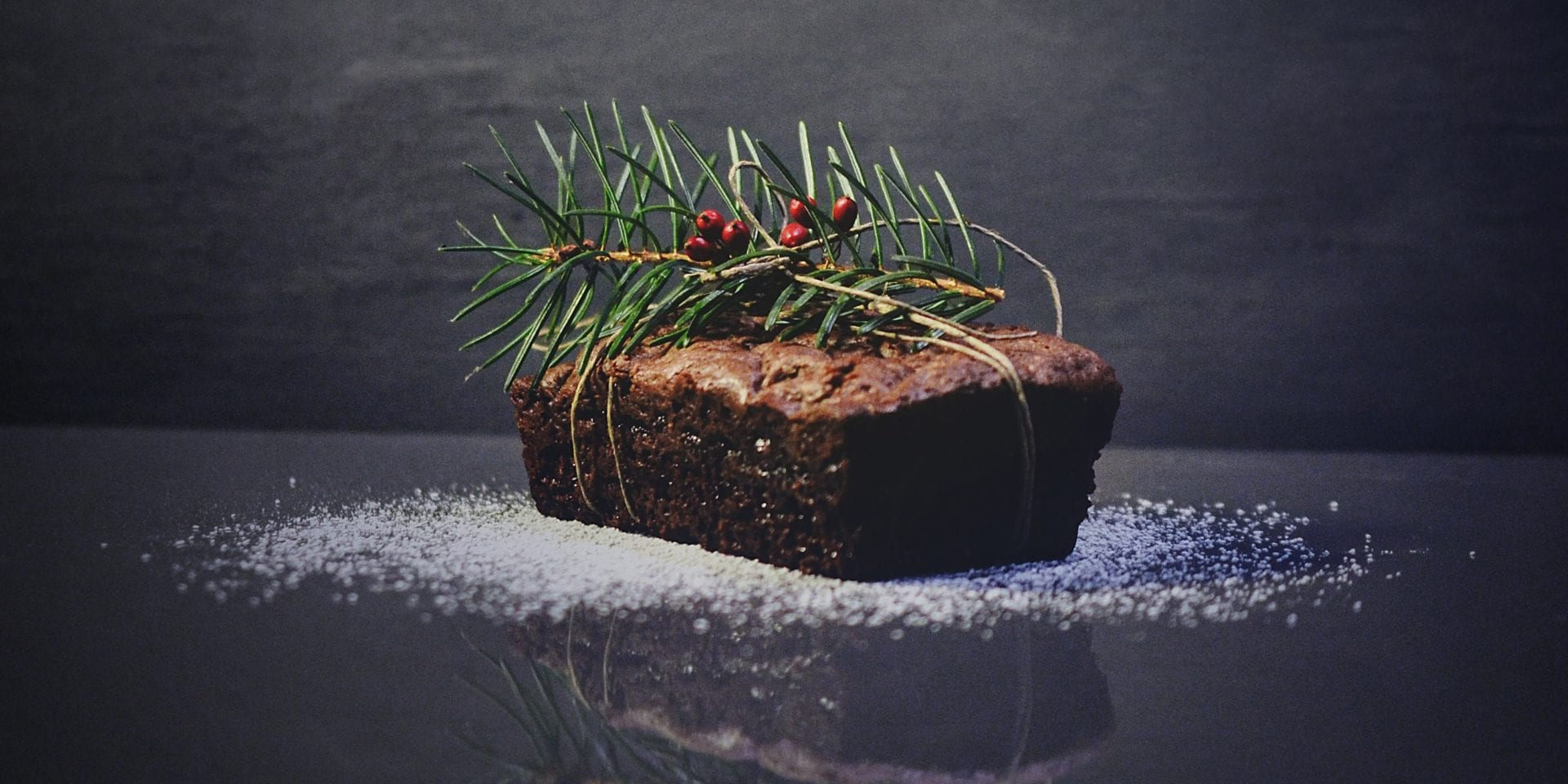 festive food: a christmas fruit loaf with a sprig of holly on top