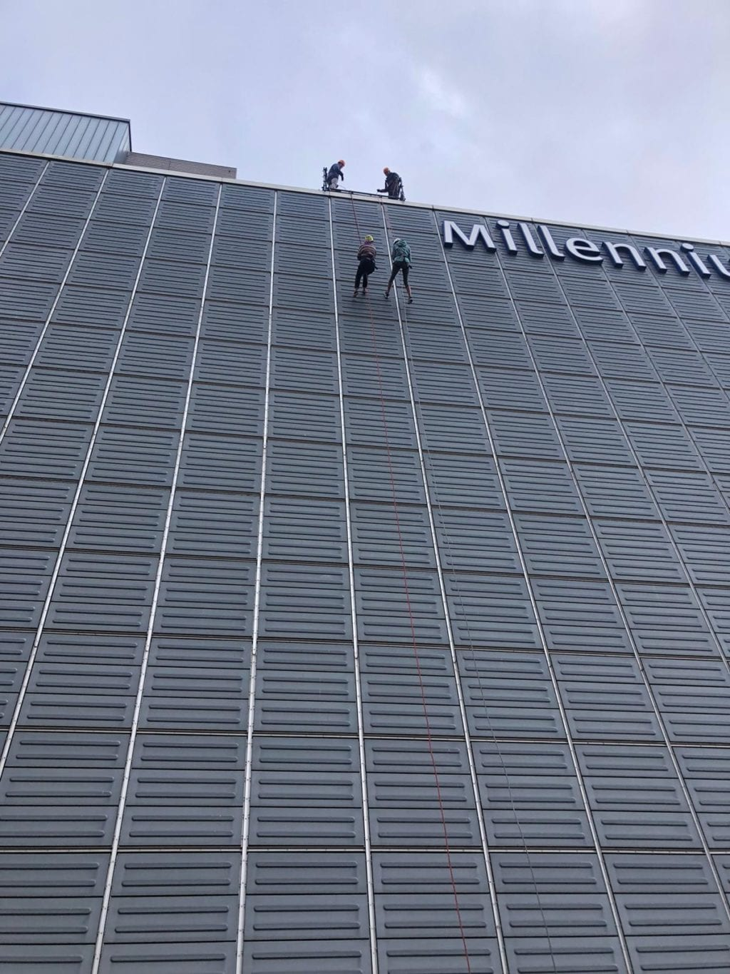 Megan Carthy and Rebecca Beale abseiling down Millennium Point for Birmingham Children's Hospital