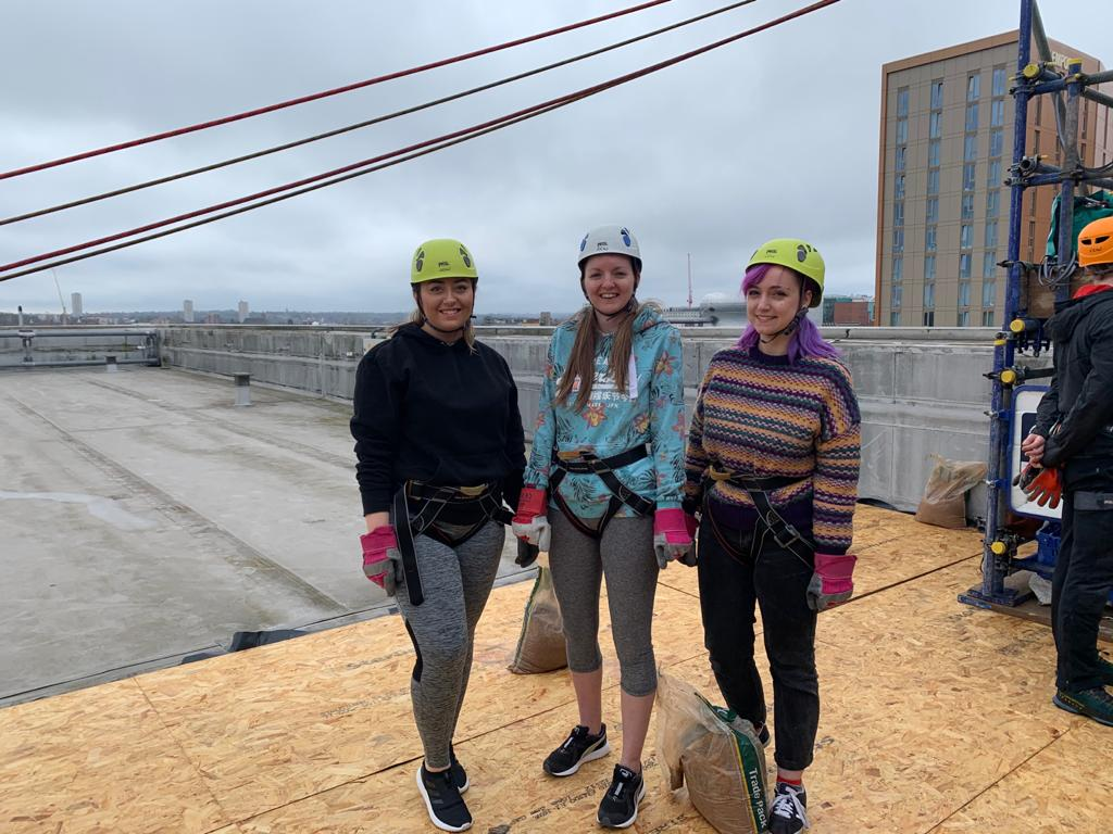 Danielle Pallett, Rebecca Beale and Megan Carthy on the roof of Millennium Point, preparing to abseil for Birmingham Children's Hospital