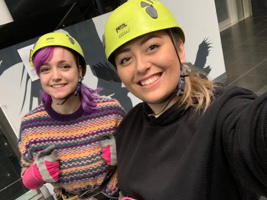 Danielle Pallet and Megan Carthy on the roof of Millennium Point, preparing to abseil for Birmingham Children's Hospital