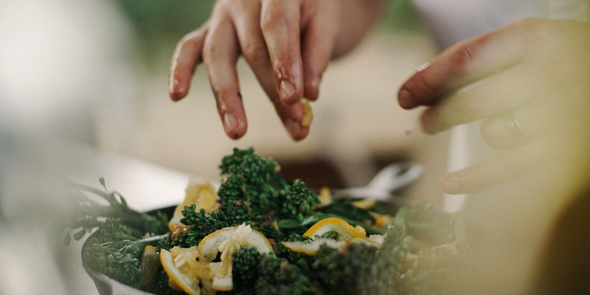 A chef preparing salad with kale and lemon – Compass Group jobs
